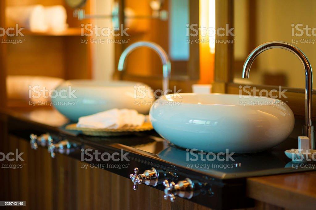 Luxury Resort Marble Bathroom Sinks and White Towels stock photo