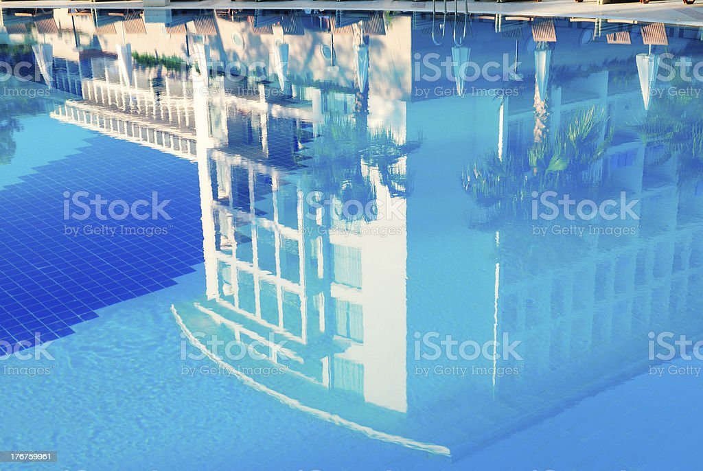 Luxury resort reflection in the pool royalty-free stock photo
