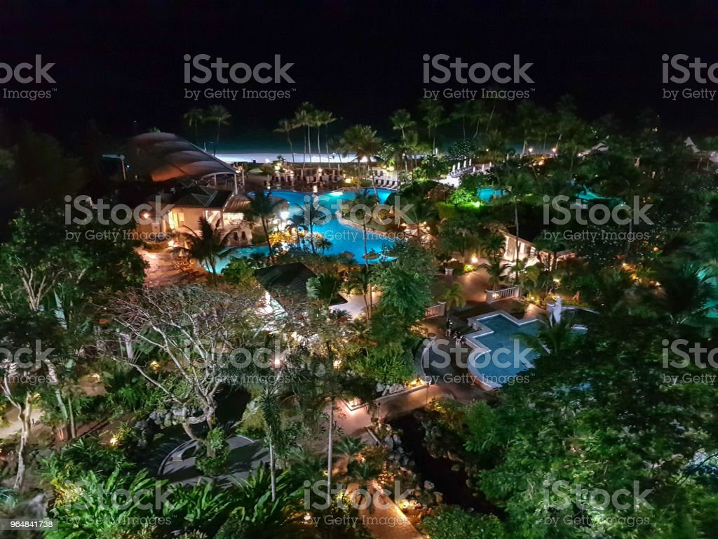 luxury resort with pool at night view royalty-free stock photo