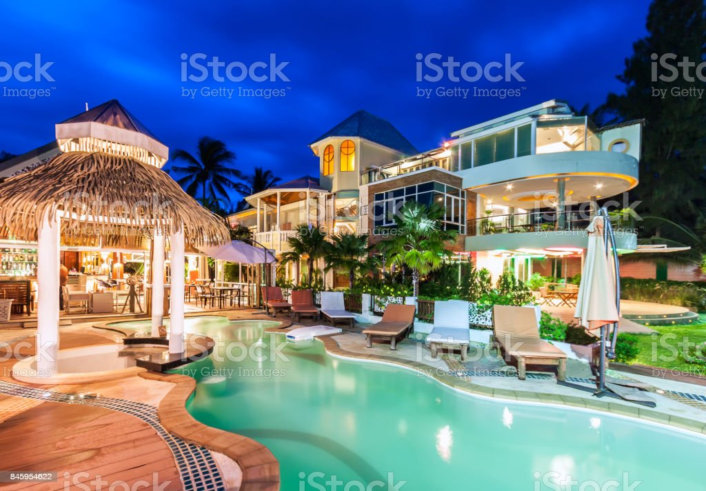 Luxury resort with swimming pool and restaurant at twiligh stock photo