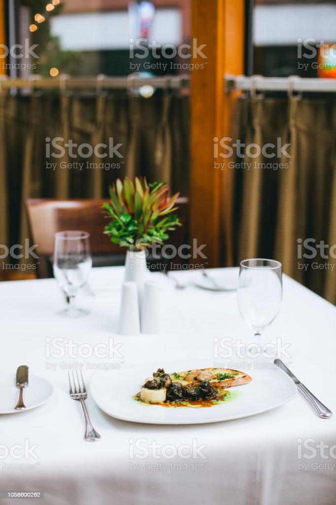 Dinner table photos of a luxury restaurant dinner, no people. This...