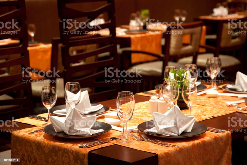 Luxury restaurant with wine glasses and table set up stock photo