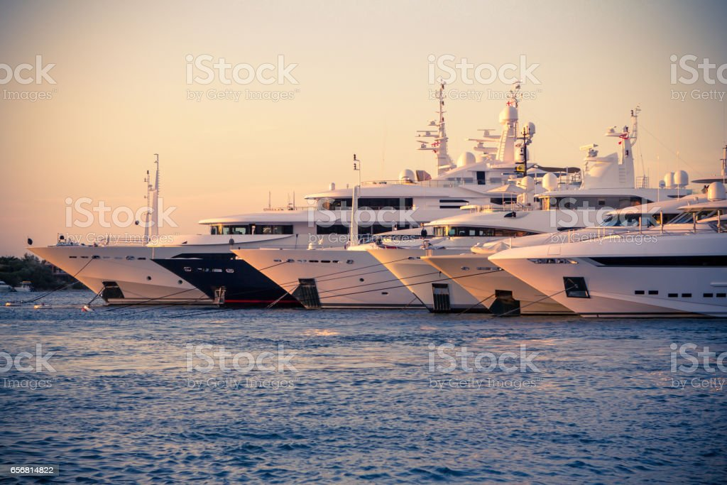 Luxury, rich Yachts moored in a harbor of Porto Cervo stock photo