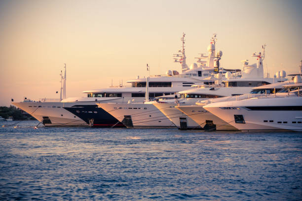 luxury, rich yachts moored in a harbor of porto cervo - segelyacht stock-fotos und bilder
