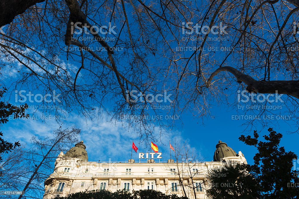 Luxury Ritz Hotel surrounded by trees in Madrid stock photo