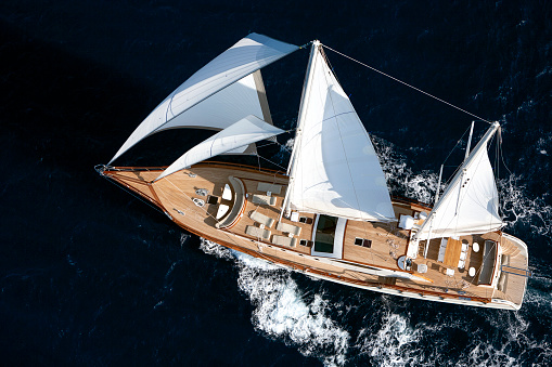 Luxury sailboat sailing in the open blue sea