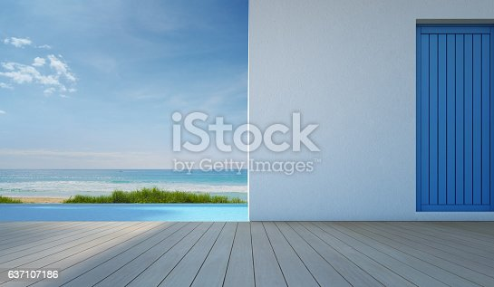 istock Luxury sea view swimming pool in modern white beach house 637107186