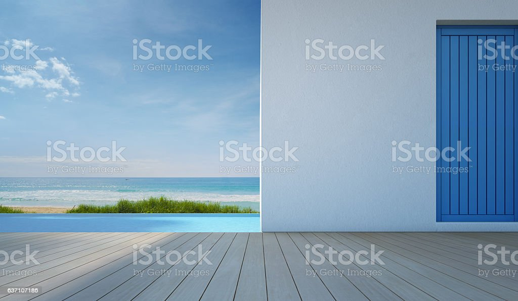 Luxury sea view swimming pool in modern white beach house stock photo
