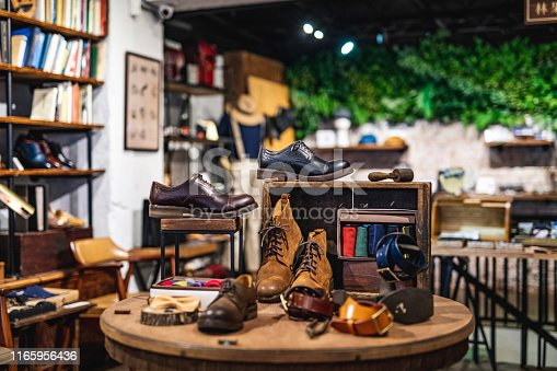 Retail display featuring a variety of high quality dress and casual shoes for men inside Taipei shoe store.