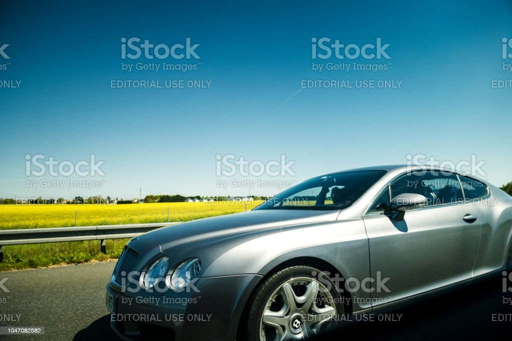 Luxury silver Bentley driving fast on highway in France stock photo