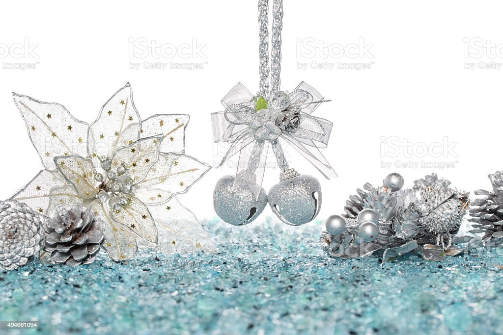 Luxury Silver jingle Bells, flower and Pine Cone on Snow stock photo