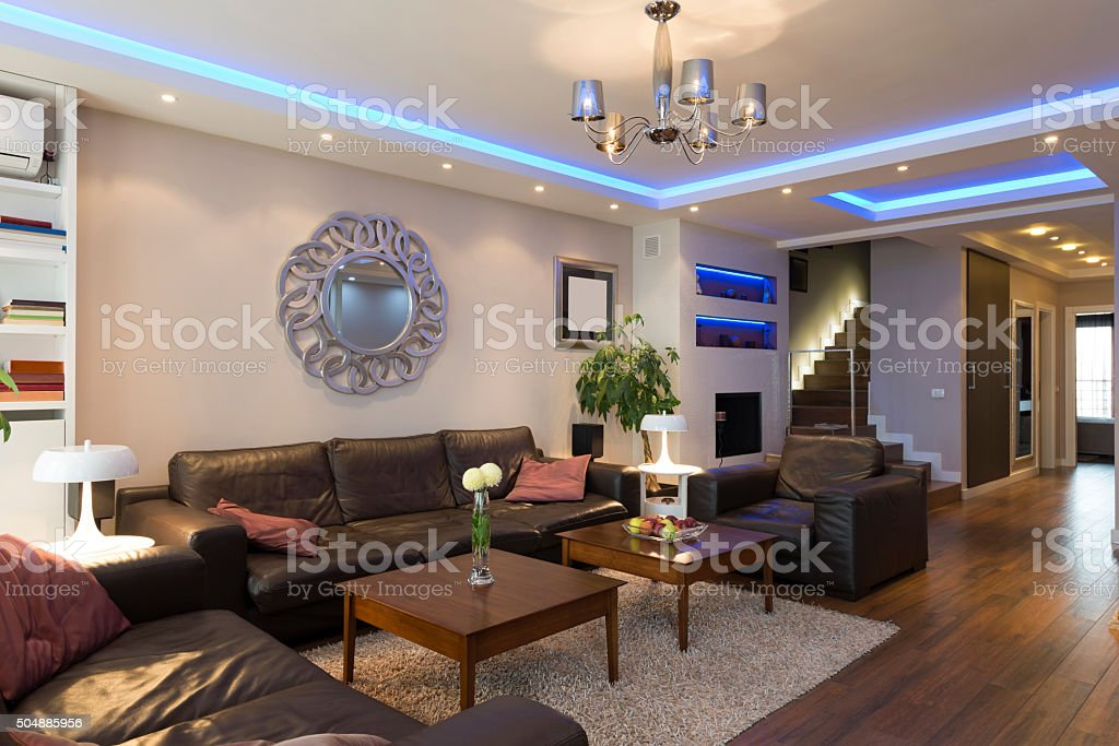 Luxury specious living room interior with modern ceiling lights stock photo
