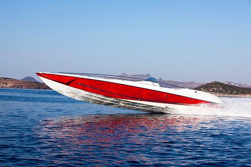 luxury speedboat speeding across the sea