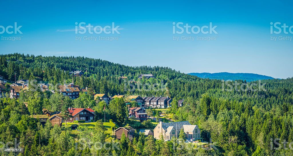 Luxury suburban homes on green forested hills overlooking Oslo Norway stock photo