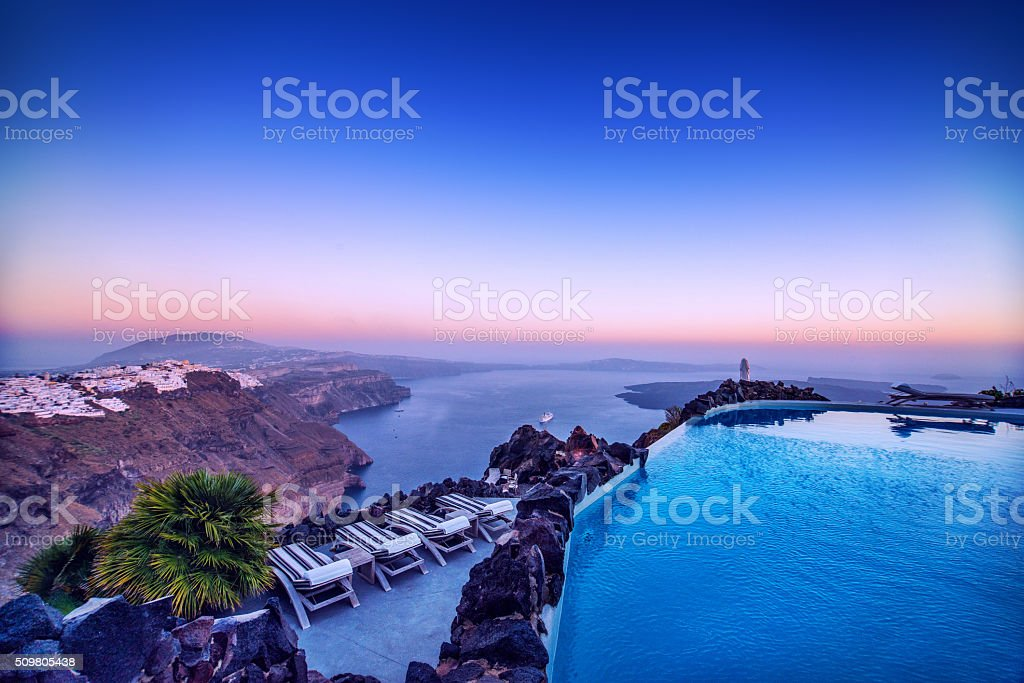 Luxury Swimming Pool at Sunset, Santorini in Greece stock photo