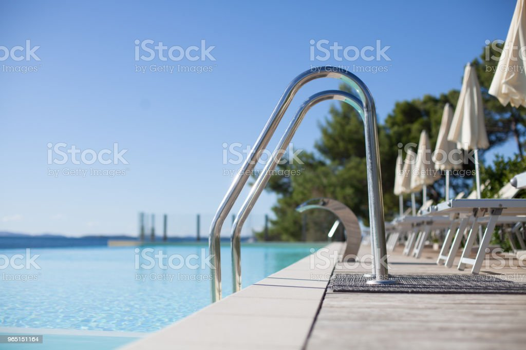 luxury swimming pool entrance with loungers royalty-free stock photo