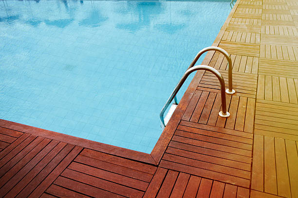 luxury swimming pool with wooden decking - competition group stock photos and pictures