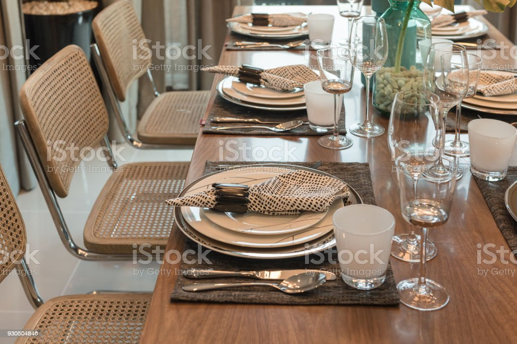 luxury table set on wooden dining table stock photo
