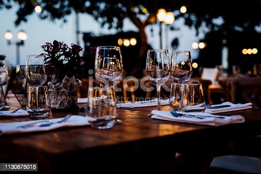 Luxury table settings for fine dining with and glassware, beautiful blurred  background. For events, weddings.  Preparation for holiday  passover, props for weddings, birthdays, and celebrati
