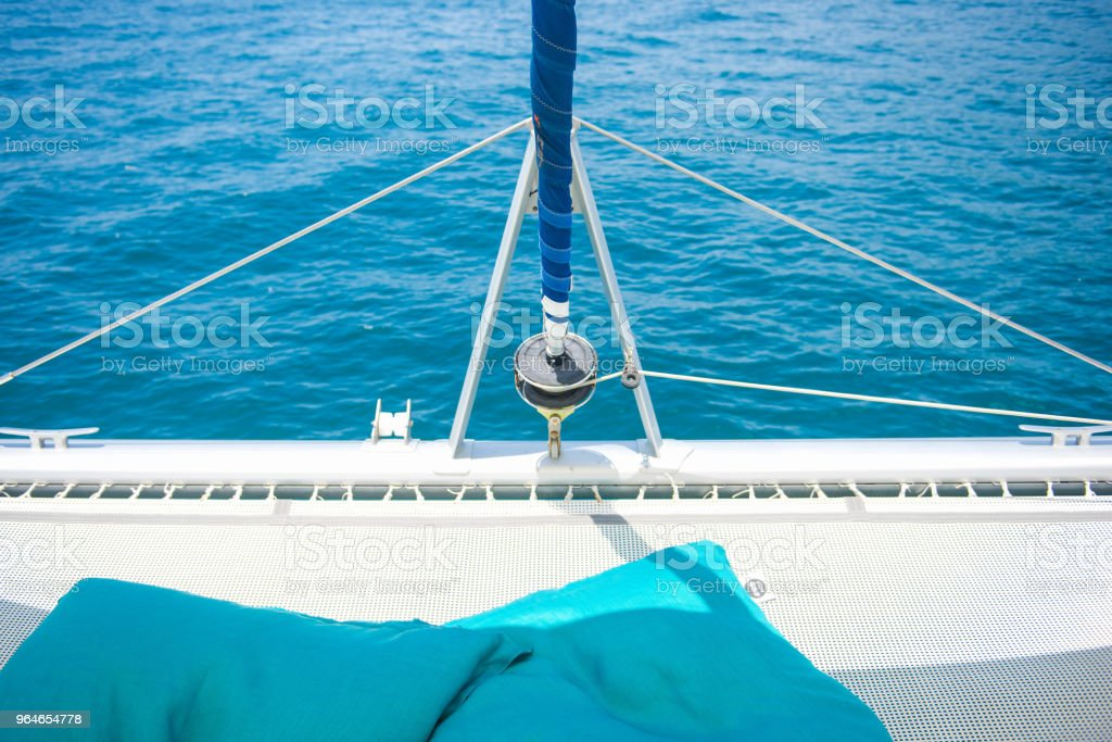 Luxury travel on catamaran sailing royalty-free stock photo