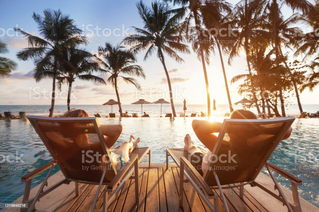 luxury travel, romantic couple in beach hotel luxury travel, romantic beach getaway holidays for honeymoon couple, tropical vacation in luxurious hotel Vacations Stock Photo