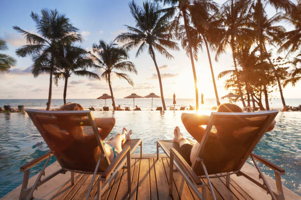 luxury travel, romantic couple in beach hotel luxury travel, romantic beach getaway holidays for honeymoon couple, tropical vacation in luxurious hotel travel stock pictures, royalty-free photos & images
