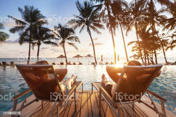Photo of luxury travel, romantic couple in beach hotel
