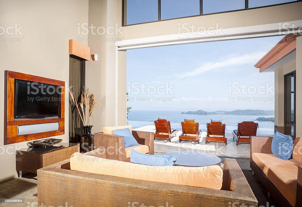 Luxury tropical home overlooking to ocean stock photo