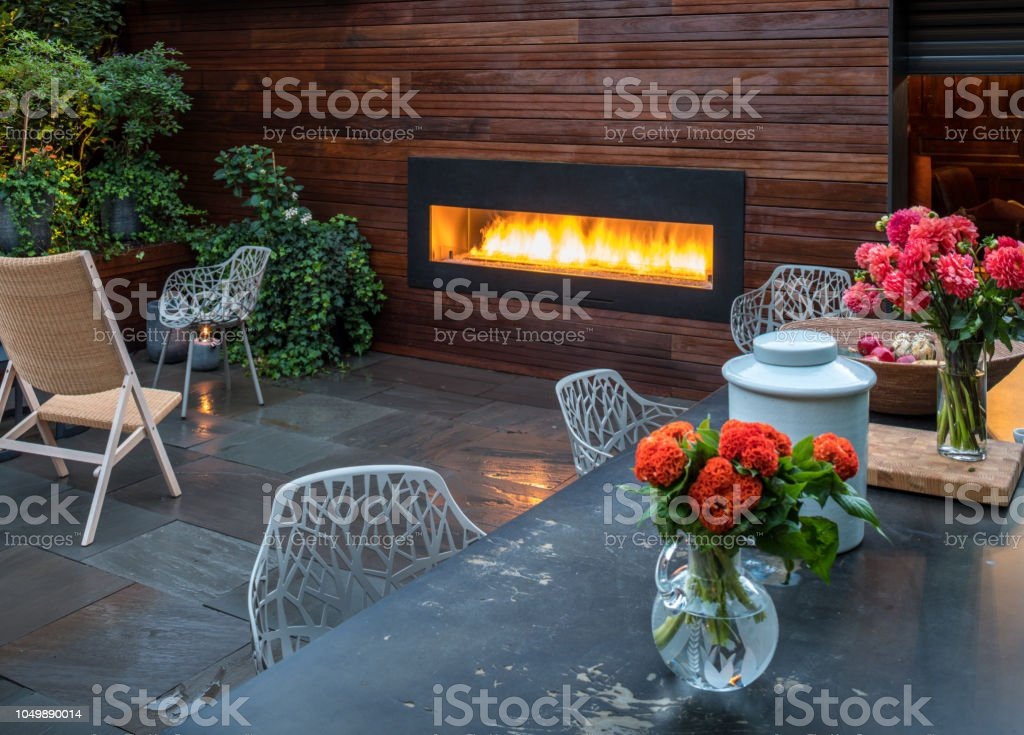 Partial view of backyard garden and patio of luxury urban home with...
