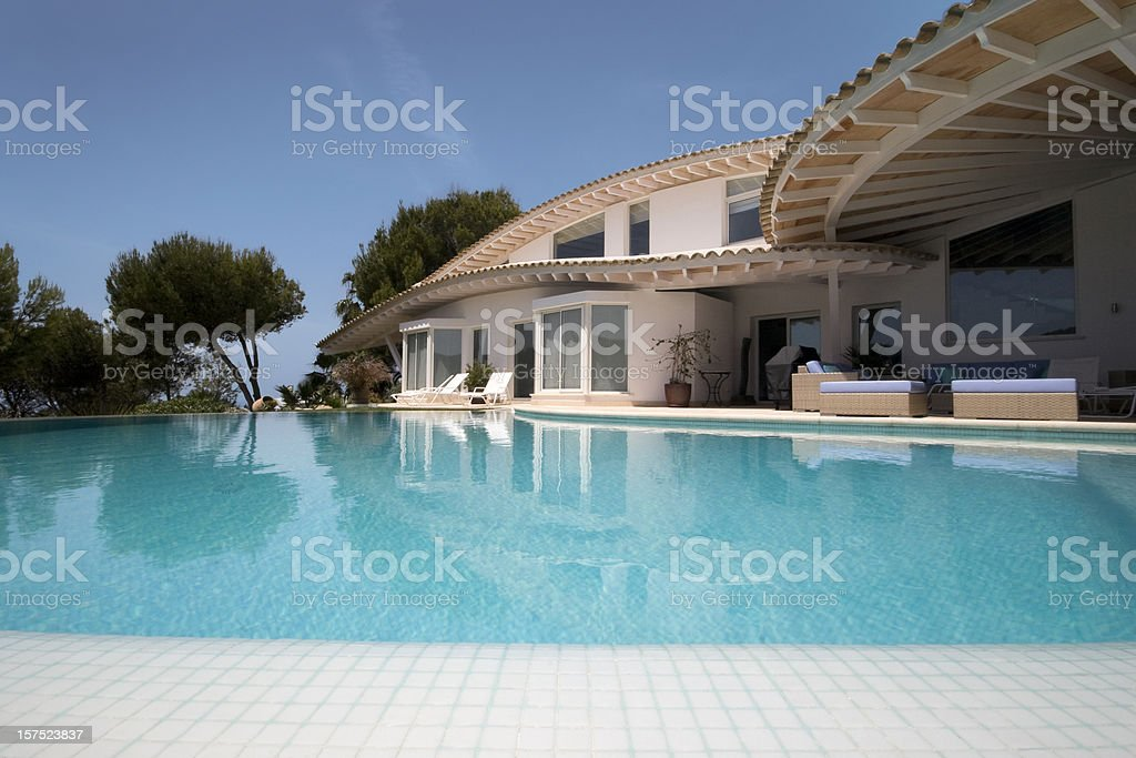 Luxury Villa and Infinity Swimming Pool royalty-free stock photo
