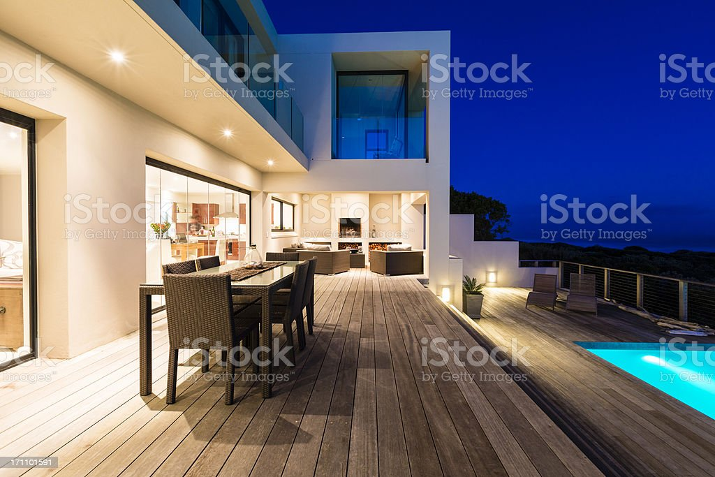 Luxury Villa Pool Deck at Dusk stock photo