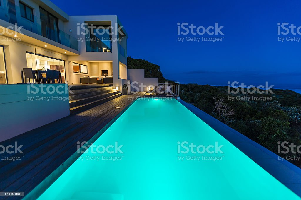 Luxury Villa Pool Deck at Dusk royalty-free stock photo