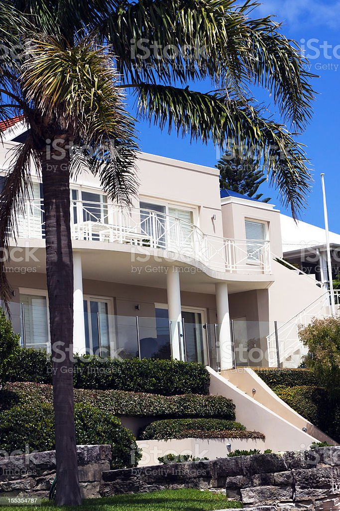 Luxury villa with columns and balcony against dark blue sky royalty-free stock photo