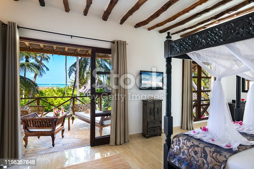 Luxury hotel suite with sea view. View from the bedroom (Zanzibar, Tanzania). Property released.