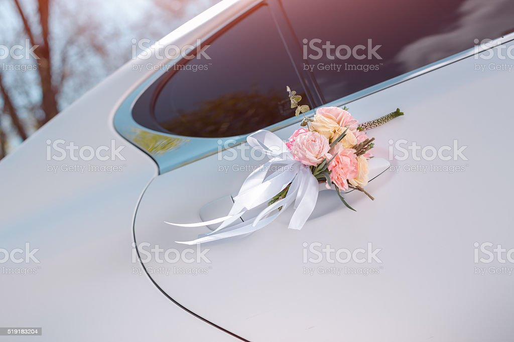Luxury wedding car decorated with flowers stock photo