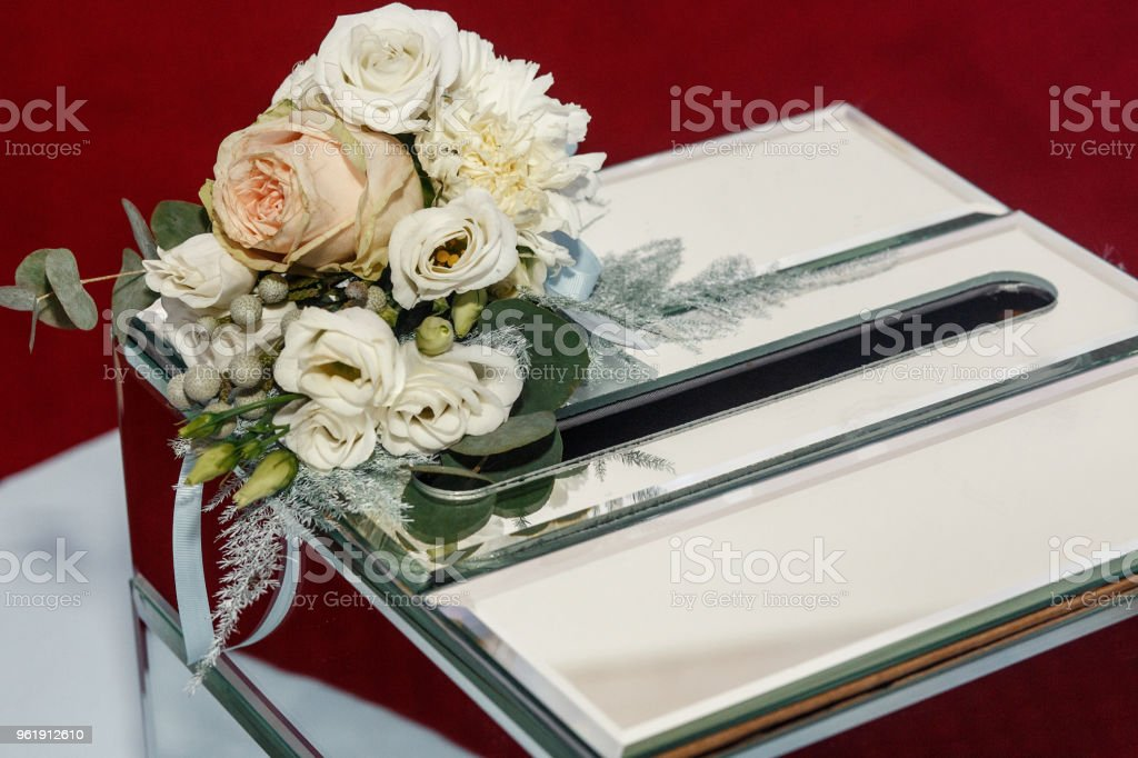 luxury wedding gift box with roses and expensive golden decor arrangements at wedding ceremony. greeting for bride and groom. expensive catering. space for text. wedding reception stock photo