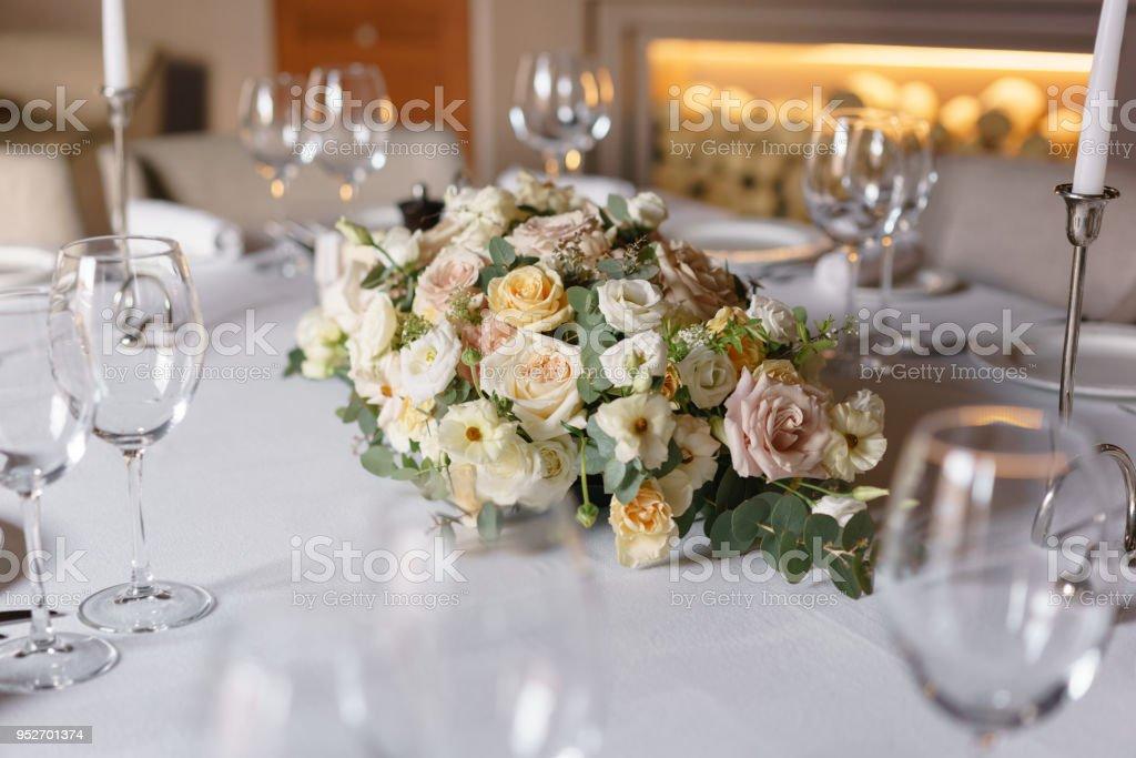 Luxury Wedding Reception Flower Arrangement On Table In Restaurant