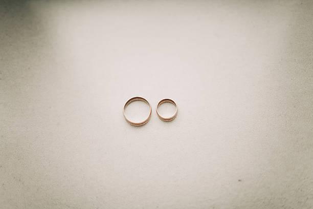 luxury wedding rings with stylish decoration near them stock photo