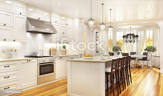 Luxury white kitchen and dining room in a large house
