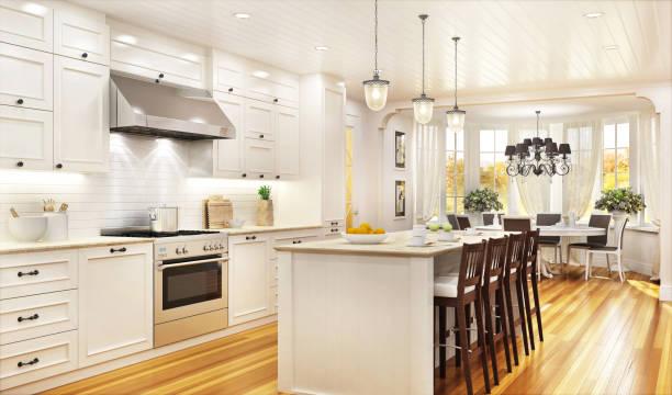 luksusowa biała kuchnia i jadalnia w dużym pięknym domu - luksus zdjęcia i obrazy z banku zdjęć