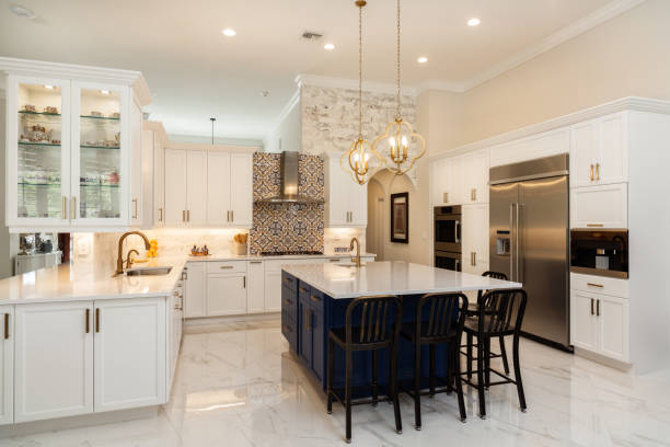 Luxury White Kitchen Design Beautiful luxury estate home kitchen with white cabinets. home interior stock pictures, royalty-free photos & images