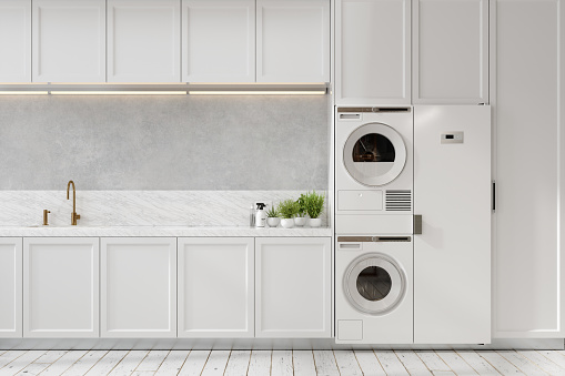 Luxury White Kitchen Interior with Laundry Room