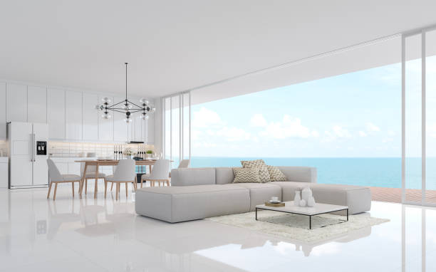 Luxury white living dining room with sea view 3d render stock photo