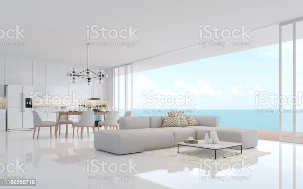Luxury White Living Dining Room With Sea View 3d Render Stock Photo - Download Image Now