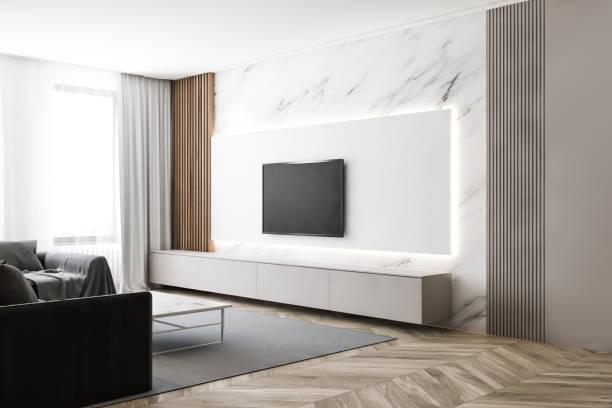 Luxuriöses Wohnzimmer aus weißem Marmor mit TV und Sofa – Foto