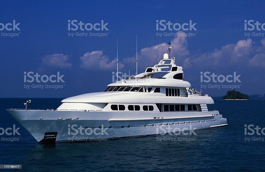 Luxury white motor yacht on a deep blue sea royalty-free stock photo