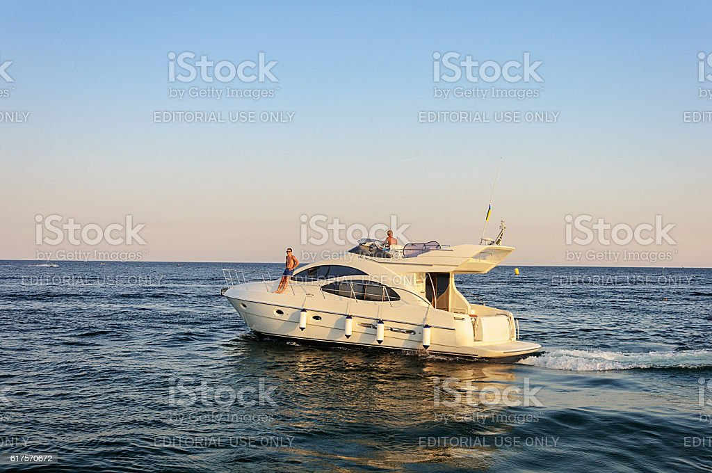 Luxury white motor yacht under way out at sea stock photo