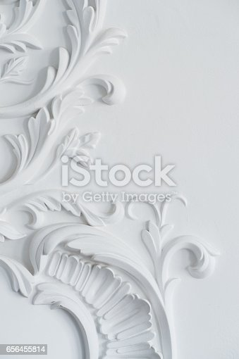 istock Luxury white wall design bas-relief with stucco mouldings roccoco element 656455814