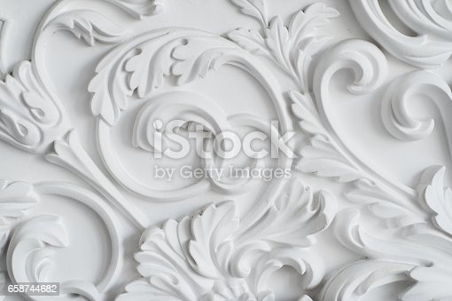 istock Luxury white wall design bas-relief with stucco mouldings roccoco element 658744682