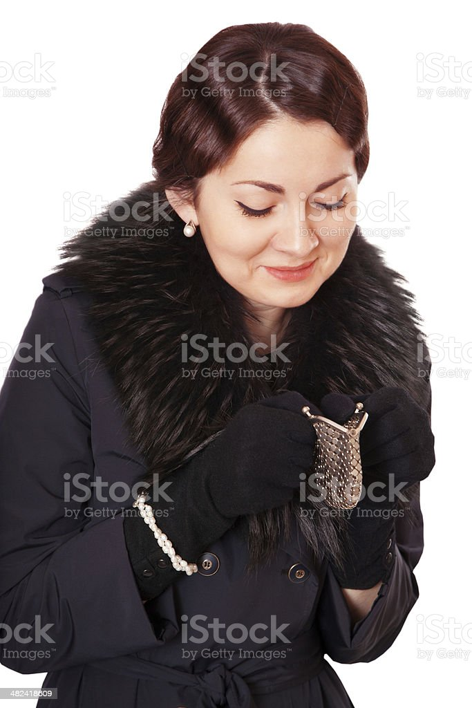 Luxury woman in a coat looks into an empty wallet stock photo